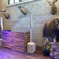 Stacked barn wood DJ booth with EV Evolve speaker system