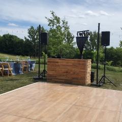 Stacked natural wood DJ booth at Farm Wedding
