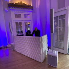 tufted-DJ-booth-white-speakers-2