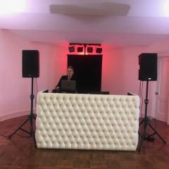 White Tufted leather DJ booth at Calhoun Beach Club