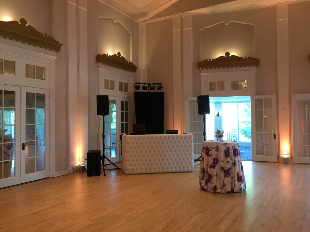 White tufted DJ booth Champagne LED uplights