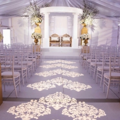 Ceremony damask pattern using 5 lights in tent