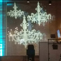 Chandelier image projection onto sheer curtains
