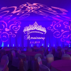 Quinceanera monogram with lighting and ceiling swirl pattern