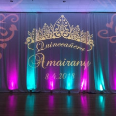 Quinceanera with purple and teal uplighting