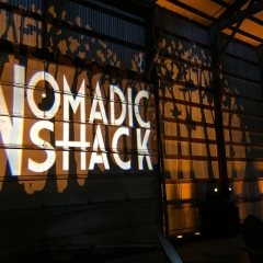 Nomadic Shack monogram with trees in background for company launch event