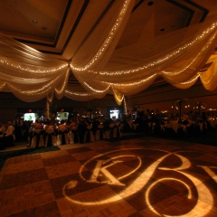 Monogram rotating on dance floor